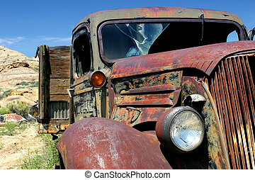 vintage farm truck - an old, abandoned, and broken down...