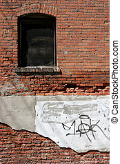 urban decay - an old brick wall along an alley, crumbling...