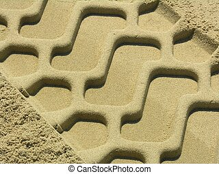Trace in the sand - The trace of a tyre in the sand on the...