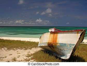Stranded - An old fishing boat on a caribbean beach