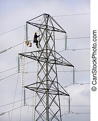 Pylon worker - Power lineman climbing electricity pylon
