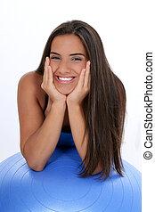 Teen Girl Exercise - Beautiful dark haired tan teen girl in...