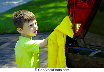 Child Washing Car - Young Boy Washing a Car SUV
