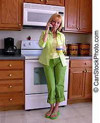 Well Hello - Smiling blonde woman, dressed in green casual...