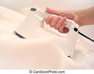 Iron - A clothes iron in white material