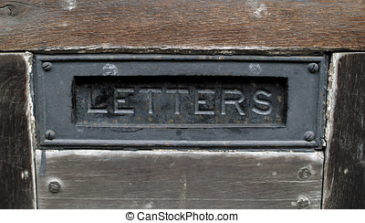 Old mailbox flap - Old metal letterbox or mailbox flap on...