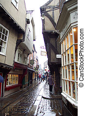 york cobbled street - very old cobbled street in York in the...