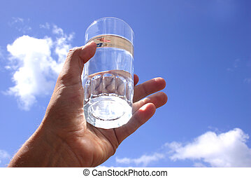 Glass of Water - Glass of water in hand and blue sky