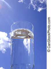 Pure Water - Tall glass of water and blue sky