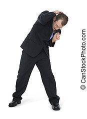 Cowering Business Man In Suit Facing forward Shot in studio...