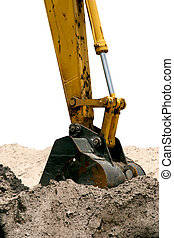 Back Hoe Isolated - A back hoe, digging up dirt.  Isolated.