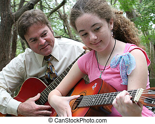 Guitar Outdoors - A father and daughter playing guitar...