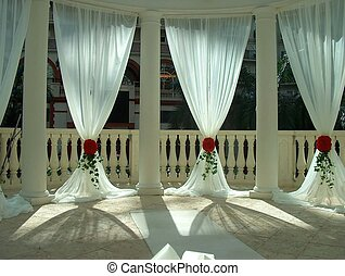 Before the wedding - Curtains in an indoor gazebo