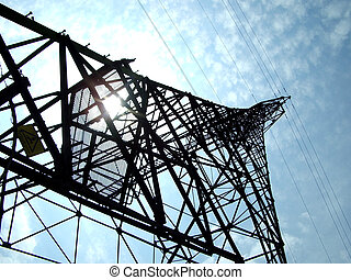 High Power Tower - sunshining throught powerline pylon,