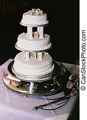 tiered wedding cake - three tiered wedding cake on a silver...