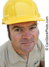 Hat Guy Close-up - A friendly looking worker in a hard hat...