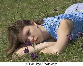 Girl and flowers - Girl on the lawn with  pasque-flowers