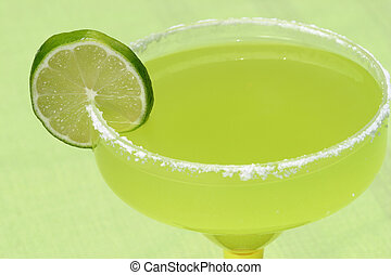 Margarita On Green - a margarita with a lime against a green...