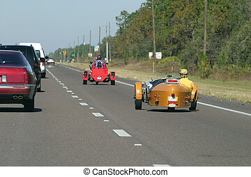 Hot Rodding 2 - Two hot rod cars traveling up the highway