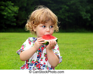 Watermelon girl - Little girl eating a slice of watermelon