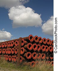 Rusty - A pile of rusty tubes lying on a meadow