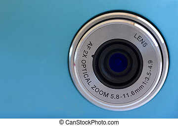 Digital Camera Lens - Isolated digital camera lens over blue
