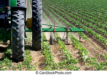 plowing up close - closeup of a farmer plowing his field