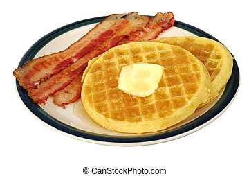 Waffles & Bacon IS - A plate of waffles with butter and...