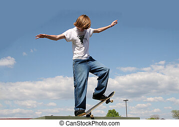 Skateboarder in Clouds - Skateboarder balancing on edge high...