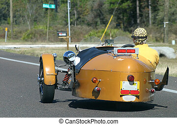 Hot Rodding 1 - a man riding down the highway in a custom...