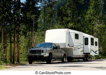 camper trailer in yellowstone - a camper trailer in...