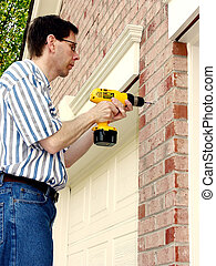 Home Improvement (1) - Drilling Holes on the exterior of a...