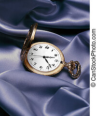 Gold Pocket Watch - Gold pocket watch on satin