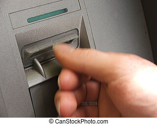 ATM transaction - hand as machine takes card