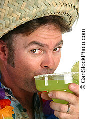 Margarita Man Sips - A man in a straw hat, hawaiian shirt &...