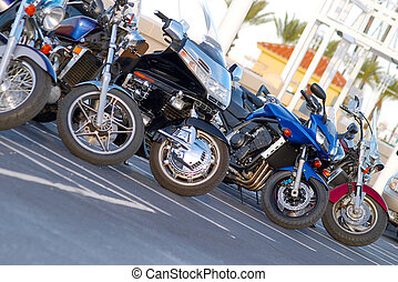 Motorcycle Lineup - five shiny, colorful motorcycles parked...