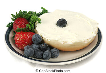 Bagel and Fruit Isolat - A bagel with cream cheese,...