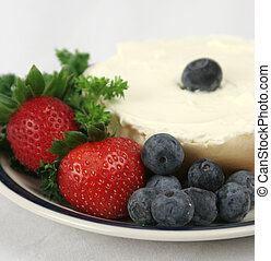 Berries with Bagel - A closeup of berries on a plate with a...