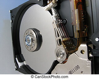 Closeup Inside A Har - A closeup of a open harddisk. The...