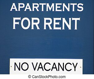 No Vacancy - A blue sign advertising that there is no...