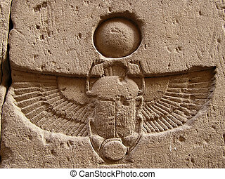 carved scarab - winged scarab beetle carved on top of door...