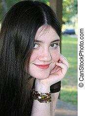 Tween Girl Portrait - Beautiful Tween Girl Sitting Outside....