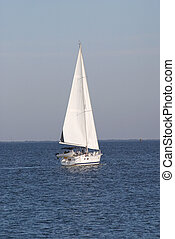Sailboat 1 - a sailboat in full sail, heading into the...