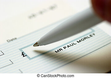 Writing a Check - A close up of a man signing a check cheque
