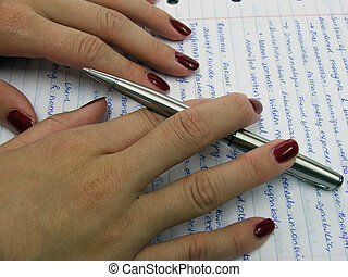 Proof reading a paper with pen in hand