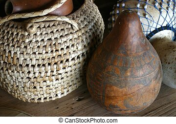 African Craftwork - African basket and carved gourd on table