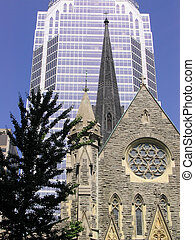 old and new - the tower and spire of an old Montreal church...