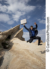 Jumping for joy - Business concepts - business anywhere on...