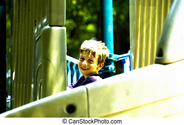Playtime - Young Boy on a Slide.  Bleached Look