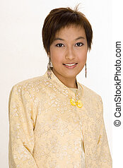 Malay Girl 6 - A pretty young Malay woman in a yellow...
